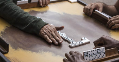 hand showing dominoes